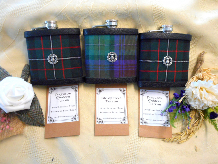 Three Tartan flasks with pewter thistle