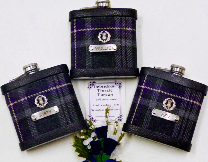 Hebridean Thistle tartan with custom engraved stainless steel tags and thistle