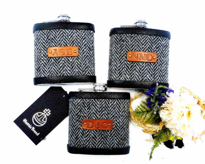 Three flasks with initials