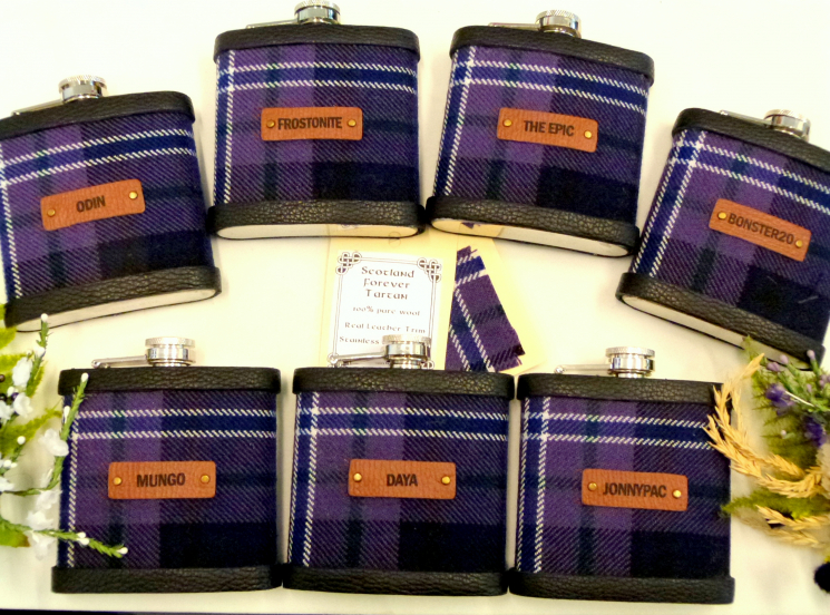 Seven flasks in Scotland Forever tartan