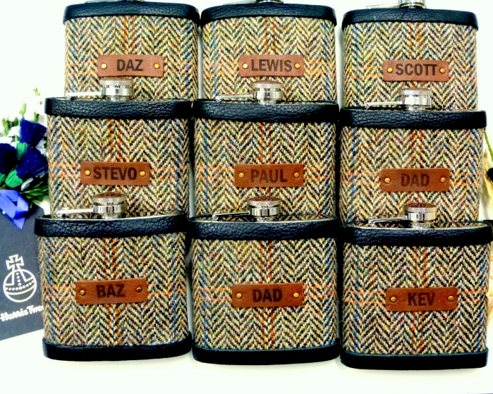 Set of Nine flasks with individual names on leather