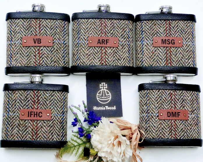 Five Harris Tweed hip flasks with initials on leather labels