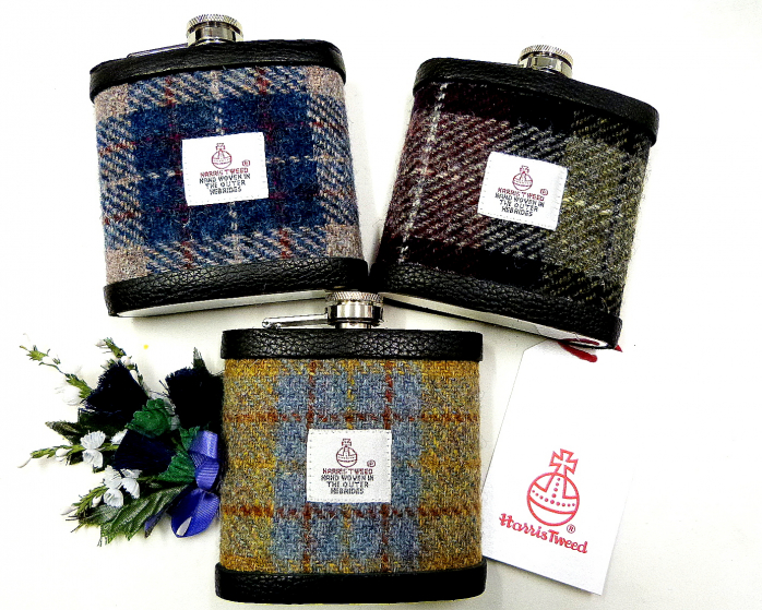 Set of three Harris Tweed flasks