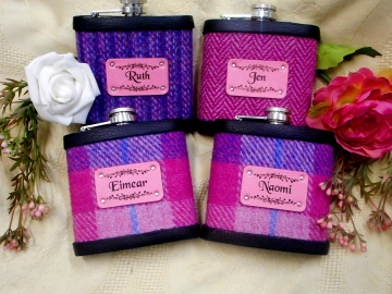 Four personalised bridesmaid's flasks with names