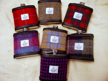 Set of seven Harris Tweed flasks