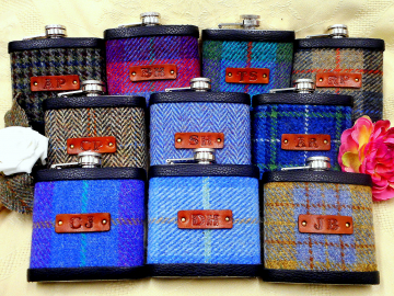 Ten Harris tweed flasks with initialss
