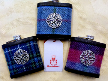 Set of three Harris Tweed flasks with hand cast pewter celtic knot