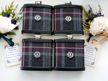 Set of four Hebridean Heather Tartan flasks with thistle